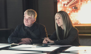 Plutarch tries to convince President Coin that Katniss should be the symbol of the rebels. Stock Photo.