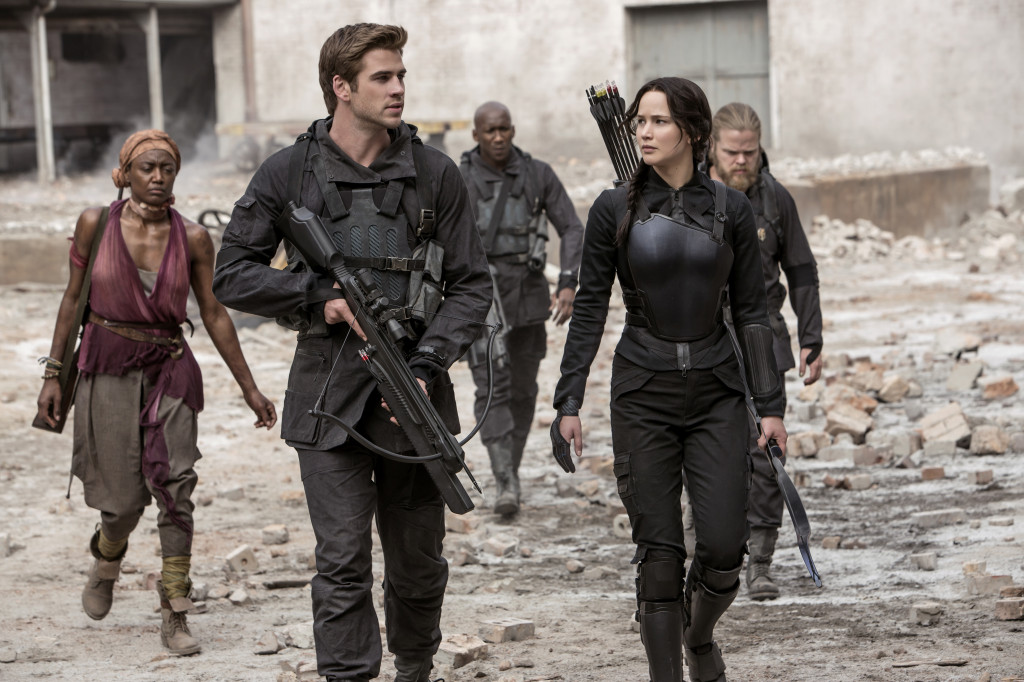 Gale (Liam Hemsworth) and Katniss (Jennifer Lawrence) travel to visit other districts. Stock Photo.