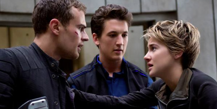 "Above: Theo James (Four), Miles Teller (Peter) and Shailene Woodley (Tris) shine in ""The Divergent Series: Insurgent."" Stock Photo."