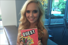 "Above: Audra LaRay Pendry shows off the ""Quest"" magazine and there is also an eBook. Staff Photos/V. Alvarez."