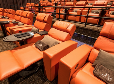 Above: iPic Theaters is the only place in Boca to kick back, relax and watch a film on the big screen. Stock Photo.