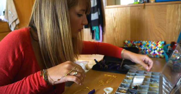 Above: Freshman Tabatha Braverman creates her own line of jewelry. Staff Photo/B. Randall.