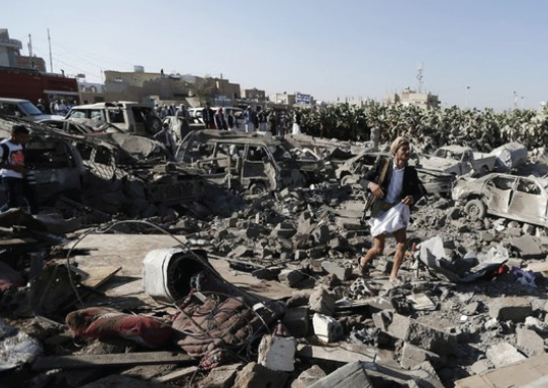 Above: The view of the damage and destruction of a recent airstrike near the Sana airport is a common scene. Stock Photo.