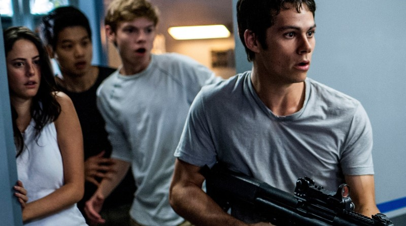 "Above: Kaya Scodelario, Ki Hong Lee, Thomas Brodie-Sangster and Dylan O'Brien fight for freedom in ""Maze Runner: The Scorch Trials."" Stock Photo."