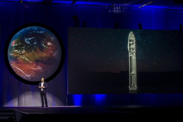 "Tesla Motors CEO Elon Musk speaks about the ""Interplanetary Transport System"" which aims to reach Mars with the first human crew in history, in the conference he gave during the 67th International Astronautical Congress in Guadalajara, Mexico on September 27, 2016. / AFP PHOTO / Hector-Guerrero"