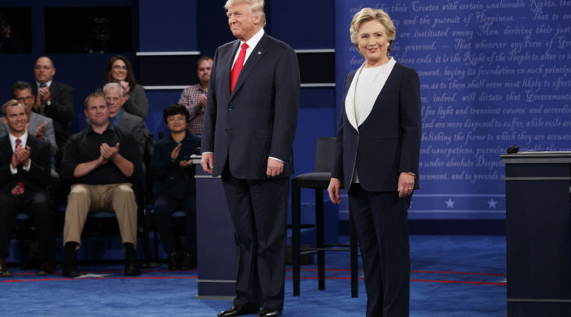 Republican presidential candidate Donald Trump, left, and Democratic presidential candidate Hillary Clinton arrive for the second presidential debate at Washington University, Sunday, Oct. 9, 2016, in St. Louis. (AP Photo/Evan Vucci) ORG XMIT: MOEV122